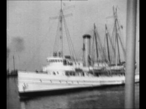us coast guard cutter and police boat in ocean with schooner smuggling contraband liquor / coast guard cutter / rear shot man on coast guard cutter... - entladen stock-videos und b-roll-filmmaterial