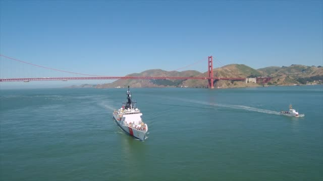 coast guard cutter bertholf returns home to alameda, san fransisco, california following a 164 day deployment to the western pacific building... - south pacific ocean点の映像素材/bロール