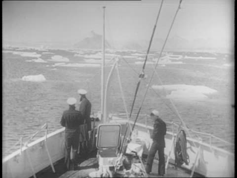 coast guard cutter ships patrol the western greenland shore / ship passes iceberg, close shot of iceberg / shot of front of ship with sailors on... - mineral bildbanksvideor och videomaterial från bakom kulisserna