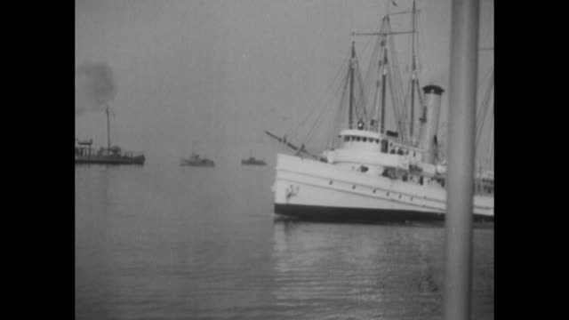vs coast guard cutters and patrol boats on water keep eye out for rum runners / ms from behind officials hail rum schooner with bullhorn / ms captain... - entladen stock-videos und b-roll-filmmaterial