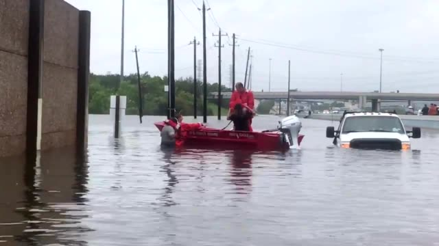 US Coast Guard flood Punt team helps survivors evacuate Houston floods during Hurricane Harvey August 27 2017 Punts are small boats teams respond to...