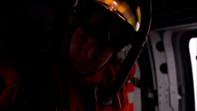 a coast guard helicopter crew member wears diving equipment as he prepares for a mission. - coast guard stock videos & royalty-free footage