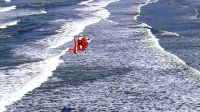aerial coast guard helicopter flying over ocean, oregon, usa - coast guard stock videos and b-roll footage