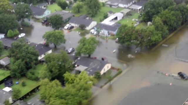 A Coast Guard MH60 Jayhawk helicopter crew from Air Station Houston rescues five people from floodwaters in a southeastern Houston neighborhood...