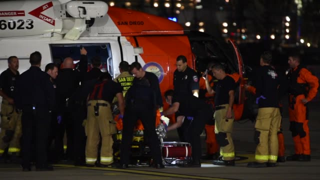 Coast Guard MH60 Jayhawk helicopter crew transfer two casualties to emergency medical services personnel at Coast Guard Sector San Diego October 20...