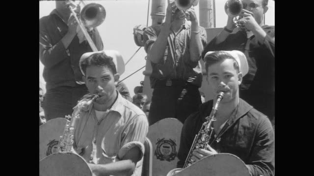 coast guard musicians play swing music as soldiers dance on deck - woodwind instrument stock videos and b-roll footage