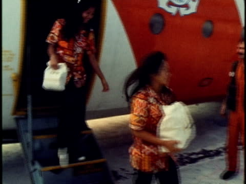 ms coast guard officers on runway at station base waiting for delivery from coast guard clipper airplane/ ms pan delivery women disembarking from... - hand an der hüfte stock-videos und b-roll-filmmaterial
