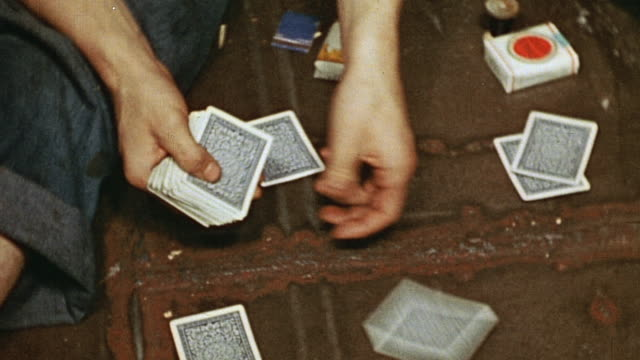 coast guard sailors playing cards among lockers shuffling dealing and reaching for cards barechested sailor wearing rosary around neck and... - sailor stock videos & royalty-free footage