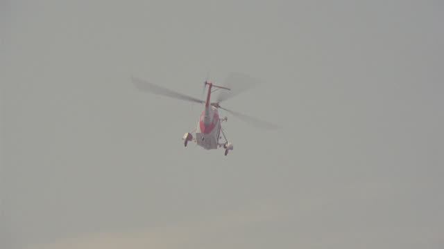 g-a coast guard sea king helicopter circles over ocean, then lands on & takes off from water - coast guard stock videos & royalty-free footage