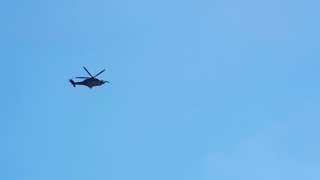 coast guard search rescue helicopter - hovering stock videos & royalty-free footage