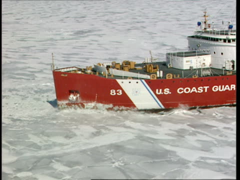 aerial,  zip,  cu,  coast guard ship,  breaking through ice on lake michigan,  michigan,  usa - lago michigan video stock e b–roll