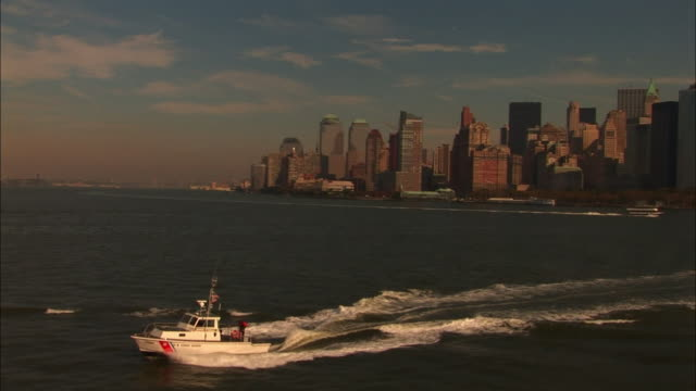 ws ts coast guard ship moving towards coast / new york city, new york, usa   - coast guard stock videos & royalty-free footage