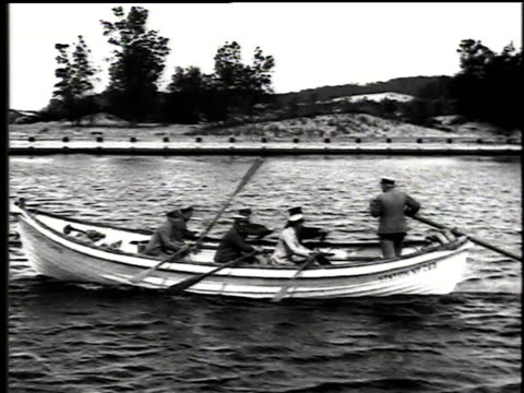 1916 montage coast guard team rowing a boat in lake michigan / united states - 1916 stock videos & royalty-free footage