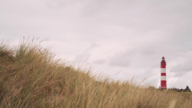 küstenlandschaft mit leuchtturm, insel amrum - nordsee stock-videos und b-roll-filmmaterial