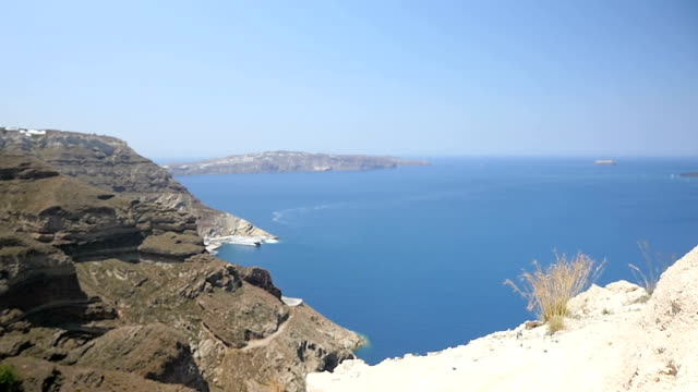coast of santorini & woman rolling up sleeve - santorini stock videos and b-roll footage