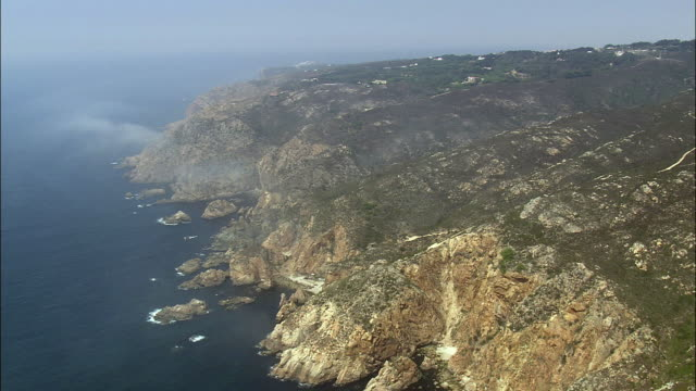 aerial ws coast with cliffs, towards cabo da roca / cascais, lisbon, portugal - cascais stock videos and b-roll footage