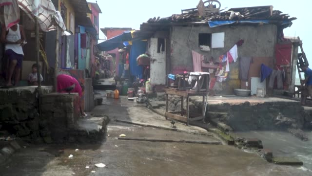 stockvideo's en b-roll-footage met coastal areas currently home to 300 million people will be vulnerable by 2050 to flooding made worse by climate change no matter how aggressively... - coastal feature