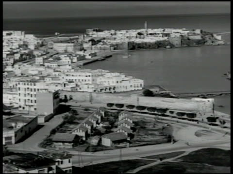 coastal city of rabat on atlantic ocean french flag on building us major general pierpont m hamilton walking up saluting shaking hands w/ french... - 1951 stock videos and b-roll footage