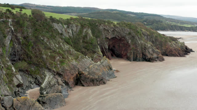 coastal cliffs at a beach in south west scotland - rock strata stock videos & royalty-free footage