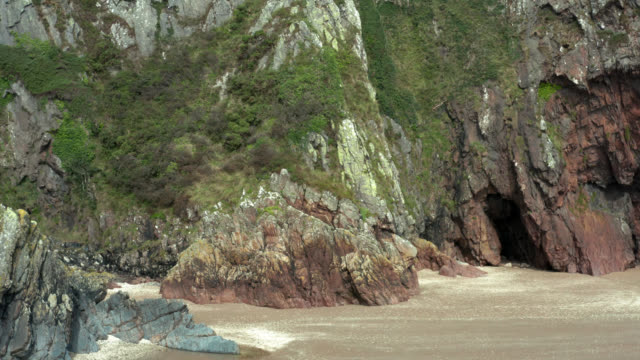 coastal cliffs at a beach in south west scotland - galloway scotland stock videos & royalty-free footage
