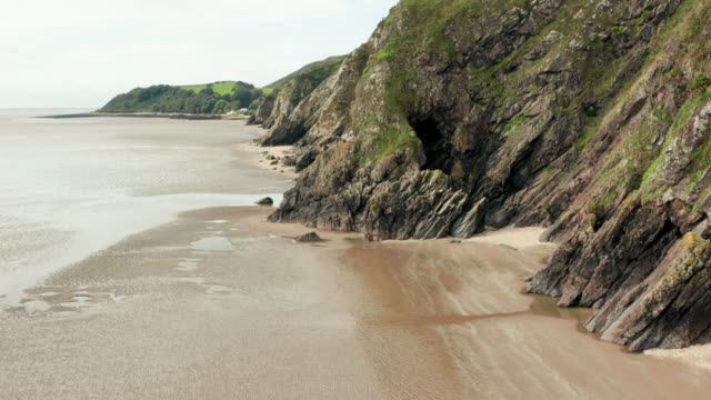 coastal cliffs at a beach in south west scotland - johnfscott stock videos & royalty-free footage