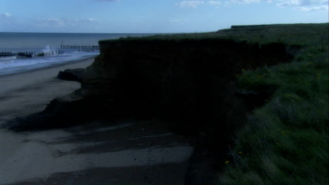 coastal cliffs show signs of erosion, happisburgh, england available in hd. - norfolk england stock videos and b-roll footage