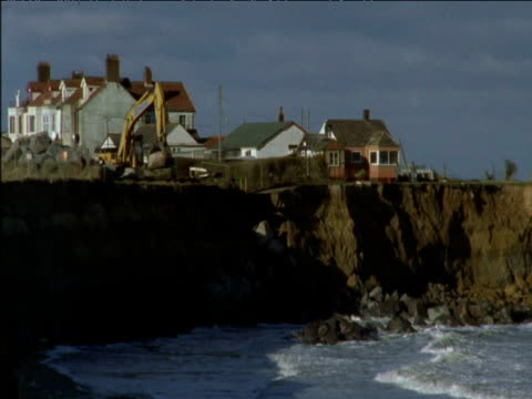 coastal defence work to protect homes from sea erosion - coastal feature stock videos & royalty-free footage