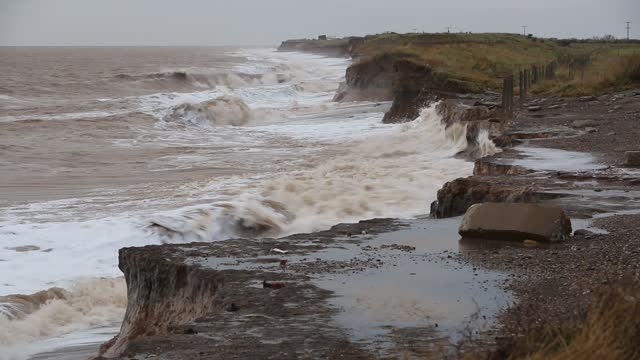 coastal erosion at spurn point. this section of coastline is the fastest eroding coastline in europe. - eroded stock videos & royalty-free footage