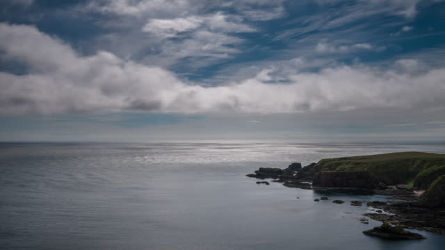 coastal landscape looking across the shimmering waters of the north sea as no clowns passover the head land at strathlethan bay - passover stock videos and b-roll footage
