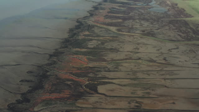 coastal marshland at low tide filmed by drone, france - eroded stock videos & royalty-free footage