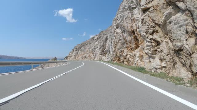 coastal road car travel - winding road stock videos & royalty-free footage