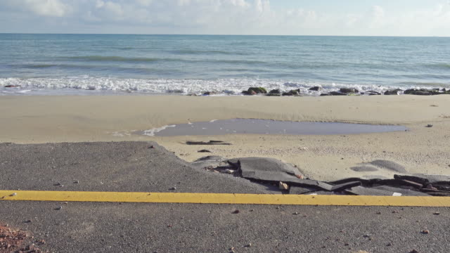 4k dolly : coastal road damaged by erosion - coastal road stock videos & royalty-free footage