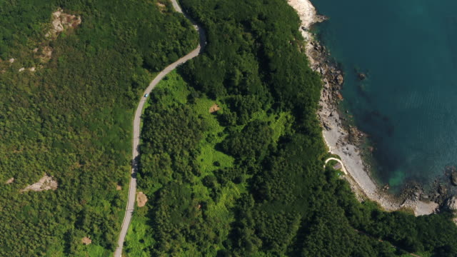 coastal road in saengildo island / wandogun, jeollanam-do, south korea - bergsvägg bildbanksvideor och videomaterial från bakom kulisserna