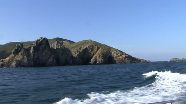Coastal scenery from boat. Channel Islands, British waters