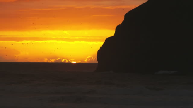 coastal sunset over the ocean - pacific city stock videos & royalty-free footage