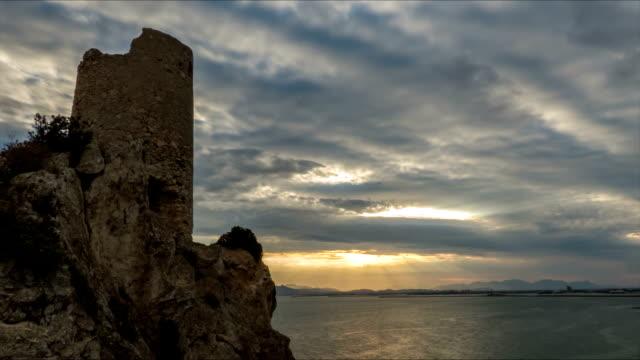 coastal tower im golf von cagliari bei sonnenuntergang - sardinien stock-videos und b-roll-filmmaterial