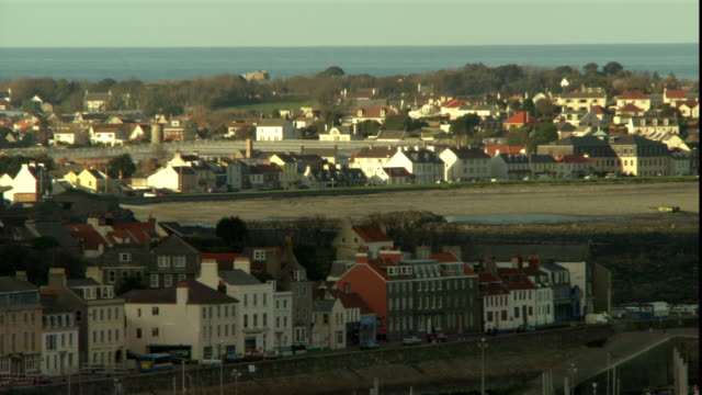 a coastal town on the english channel is seen from above. - kanalinseln stock-videos und b-roll-filmmaterial