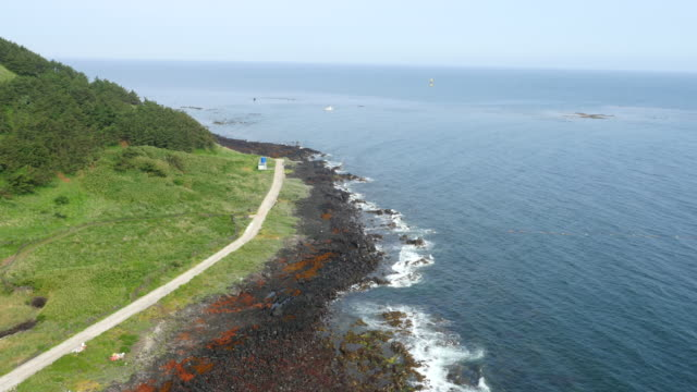 coastal view of biyangdo island (famous tourist attraction) in jeju island - coastal road stock videos & royalty-free footage