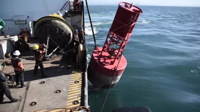 coastguard cutter aspen travelled to humboldt bay to recover and replace navigational aids to assist ships transitting the humboldt bay entrance. - hochziehen stock-videos und b-roll-filmmaterial