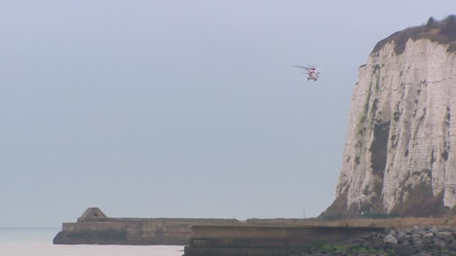 a coastguard helicopter flying around kingsdown in kent to check for migrants attempting to cross the english channel into the uk from france - english channel stock videos & royalty-free footage