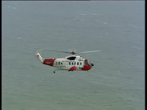 Coastguard helicopter in flight over sea Isle of Portland