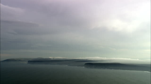 coastline approaching hoy  - aerial view - scotland, orkney islands, united kingdom - hoy stock videos & royalty-free footage
