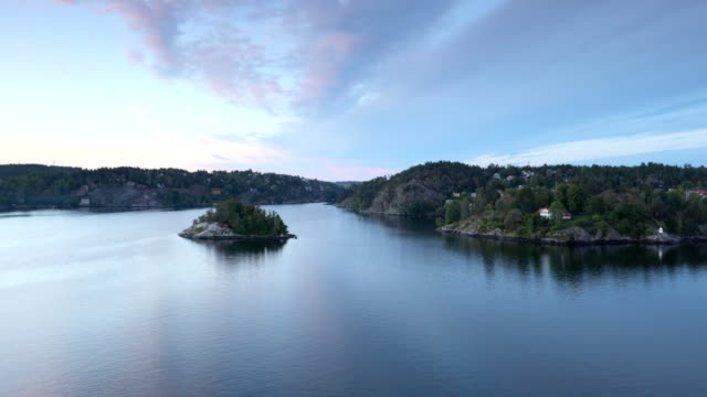 coastline of stockholm archipelago with the islet of sweden viewed from a cruise ship in early morning - arcipelago video stock e b–roll