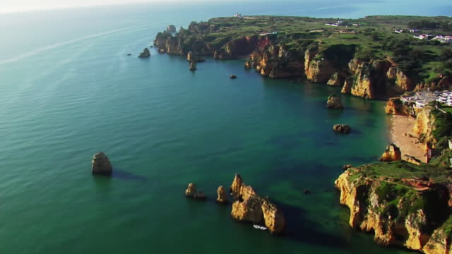 aerial, coastline ponte da piedade and lighthouse, portugal - portugal stock videos & royalty-free footage