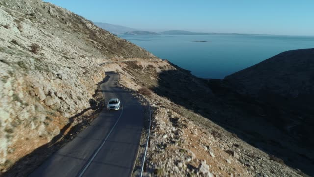 coastline road across island krk in the mediterranean adriatic sea - coastal road stock videos & royalty-free footage