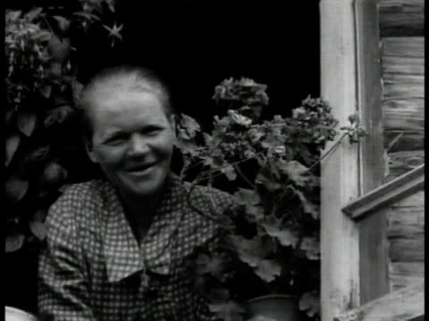 stockvideo's en b-roll-footage met coastline village. fair haired people blonde children. canal w/ dredging machine connecting white sea & baltic. - 1935
