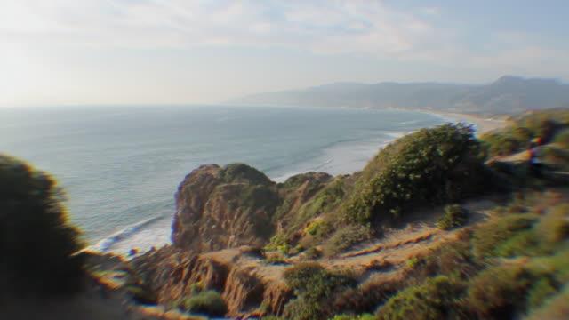 ws selective focus coastline with cliff overlooking bay / los angeles, california, usa - mit handkamera stock-videos und b-roll-filmmaterial