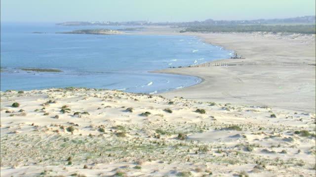 LOW AERIAL Coastline with shipwreck / Israel