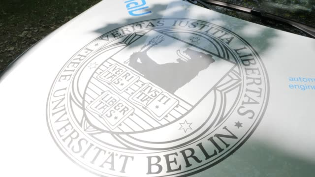 Coat of arms of the Free University Berlin on an electric driverless vehicle which can be seen at the Dahlem Center for Machine Learning and Robotics...