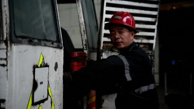 coated in thick black dust hundreds of miners emerge after another shift gouging out the coal that fuelled chinas boom and its choking pollution an... - newly industrialized country stock videos and b-roll footage